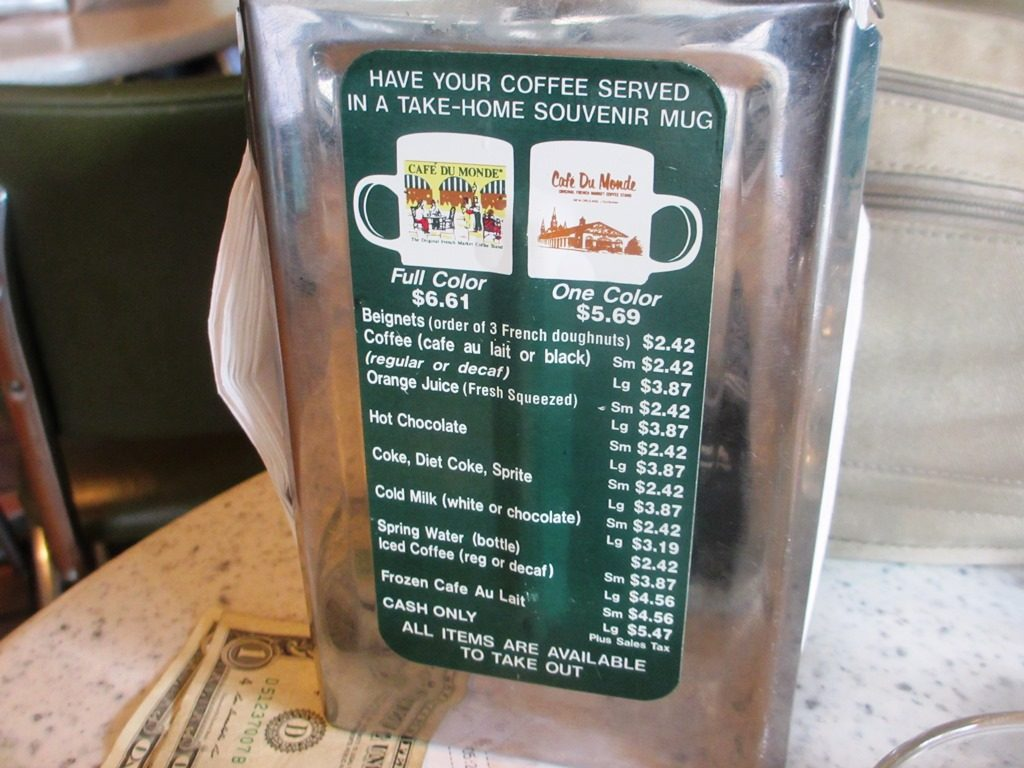 Café Du Monde simple menu, on the table's napkin holder.