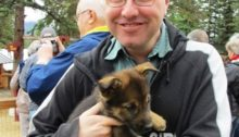 Erik Tomren with Alaskan husky puppy.
