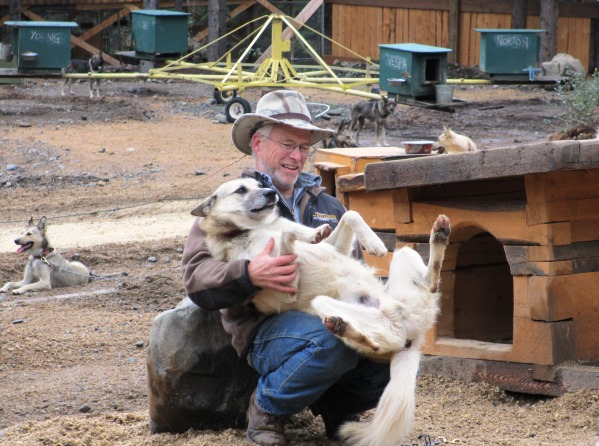 Jeff King with Alaskan husky puppy at Husky Homestead.