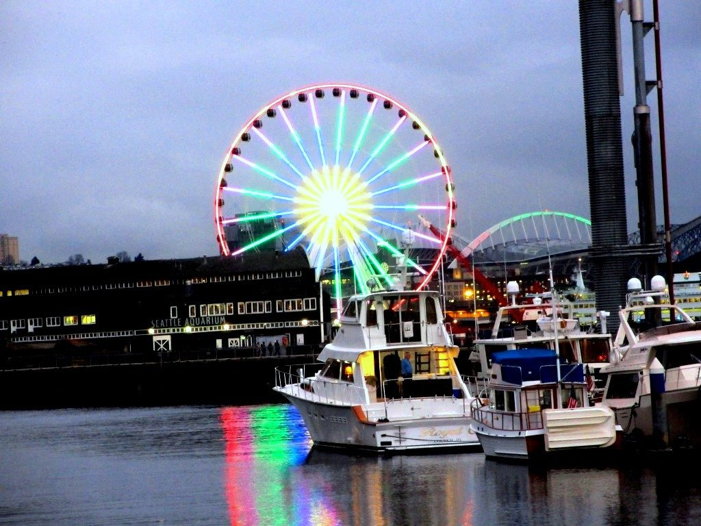 Seattle Great Wheel on New Year's Eve, with boat.