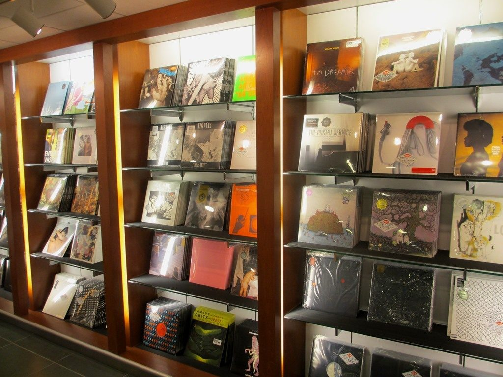 Wall of vinyl releases at Sub Pop Airport Store.