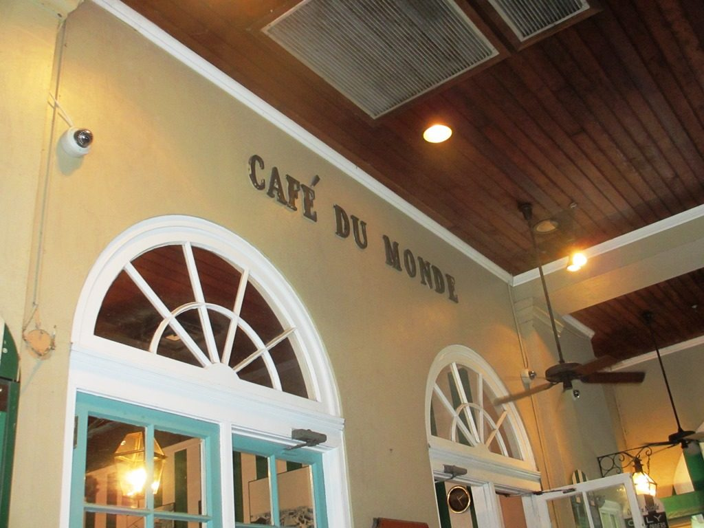 Café du Monde sign from seating area. Located in the French Quarter in New Orleans, Louisiana.