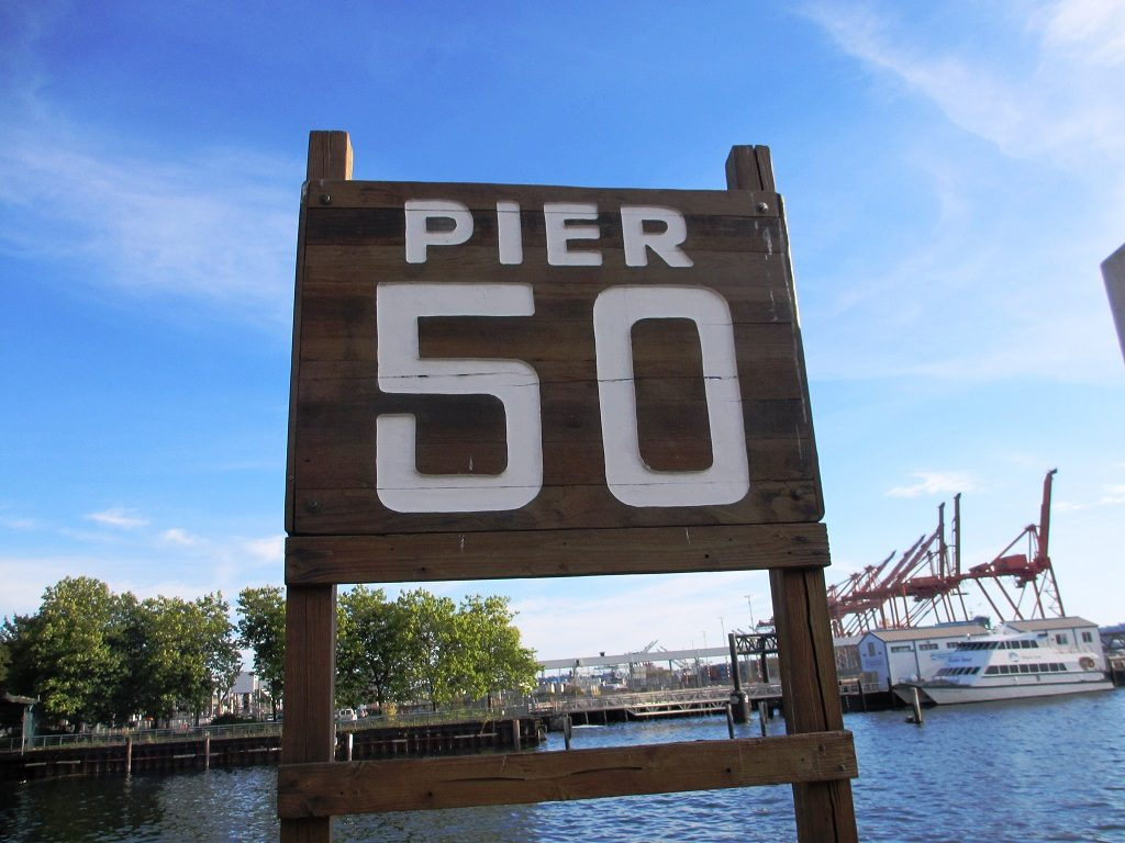 Wooden sign for Pier 50 in downtown Seattle.