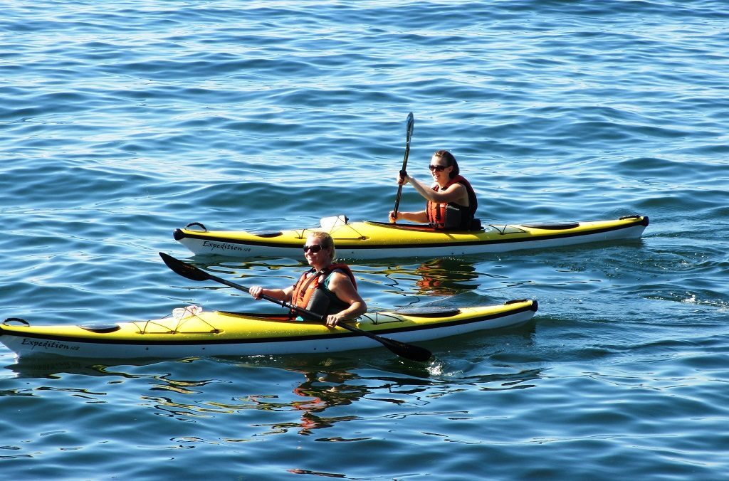 Kayakers enjoying the summer weather in West Seattle (Alki Beach).